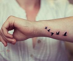 Not sure I would do birds, but I like the placement... Maybe a heart for each person in my family...?