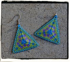 Hey, I found this really awesome Etsy listing at http://www.etsy.com/listing/114962418/boutique-custom-triangle-flowers-beaded