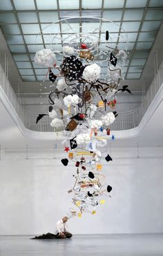 Contemporary artist Gilles Barbier's sculptural installation titled L'ivrogne, translated as The Drunk, depicts a sullen man, down on his luck.