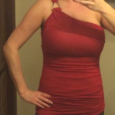 Cute red top Cute red top with silver hardware. Can be dressed up or down. Studio Y Tops Tank Tops