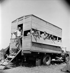 H.K. Townsend (standing) brought group of out of town Jehovah's Witnesses from Clarksburg WV to the convention in a wooden jury rigged bus. 1947.