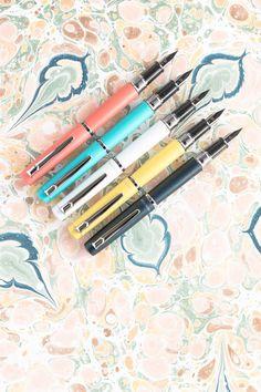 Platinum Procyon Fountain PensColorful aluminum screw-cap fountain pens with a steel nib. Fancy Pens, Goulet Pens, Pen Collection, Screw Caps, Fountain Pen Ink, Writing Instruments, Stationery, Parker Pens, Pen Pen