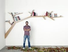 Tree branch bookshelf! Cute idea!