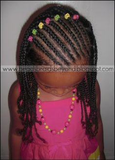 Slanted Cornrows and Natural Box Braids. Love this for my chocolate girl. Good opportunity to practice cornrows without doing her entire head (larger box braids in the back). Probably would need to add yarn for length.