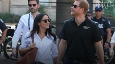 Harry and Meghan Look Totally in Love Holding Hands at Invictus