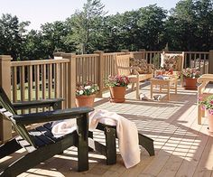 "Classic Deck Railing ""Easy and inexpensive to build, this classic deck railing features 6x6 posts, 2x4 rails, and 2x2 balusters. Trim around the post tops adds a touch of flair."""