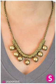 $5.00 Lucky Strike - Brass:  Countless brass rings and classic brass beads are threaded along a strand of rounded box chain in a matching brass tone. Features an adjustable clasp closure.  Sold as one individual necklace. Includes one pair of matching earrings.