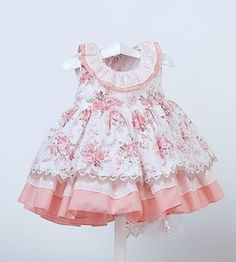 Sweet Dress with lots of ruffle layers. Love the rose print with the pink. The tiny rose print bias neck helps the collar ruffle stay down. Little Dresses, Little Girl Dresses, Cute Dresses, Girls Dresses, Toddler Dress, Baby Dress, Toddler Girl, Kids Frocks, Girl Dress Patterns