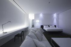 Minimalist bedroom inside the 150M Weekend House in Thailand by Shinichi Ogawa & Associates _