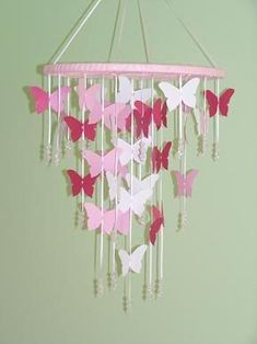 DIY butterfly chandelier… for the girls room ♥  Its little girly but I want to add some pink in my room make it horses instead >:D