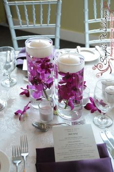 Floating Candle Centerpieces. Since it's a day wedding on a boat- probably don't need candles