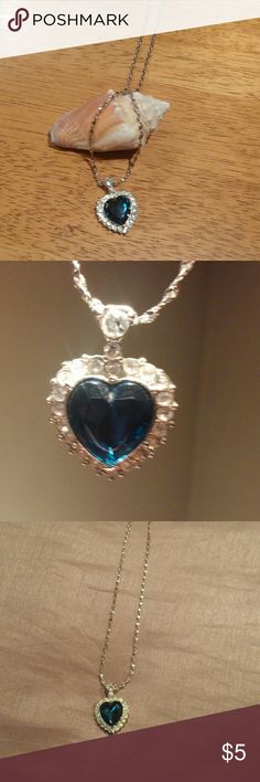 Heart shaped necklace Beautiful cosmetic blue sapphire heart surrounding by diamonds shape necklace with very unique silver necklace. 18 inch necklace. Jewelry Necklaces