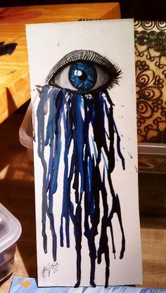 Paint an eye onto the canvas and then glue small pieces of crayon underneath it. Melt the crayons with a hair dryer and you'll get an effect like this!