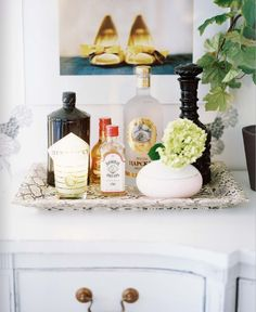 all you really need to serve cocktails at home is a pretty tray and some enticing liquors ~ Abode Love