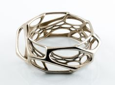 Prefer it as a ring, I like the idea of having multiple layers. Something simple yet intricate.