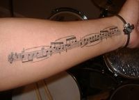 If I get this done, it will be Beethoven (Ode to Joy or Moonlight Sonata) Tattoo picture of Music notes http://www.everytattoo.com