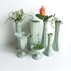 Shabby Chic Upcycled Vase Collection... Set of 7... Mint Green Vases... Wedding Table Decor... Shower decoration...Embellished Vases. $52.95, via Etsy.
