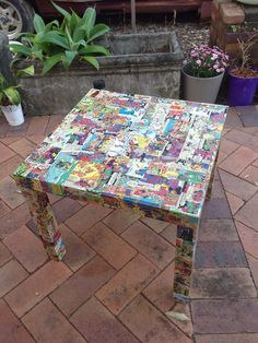 Hacked Ikea Lack table - $10. Vintage French comics (my husband's) were cut up and used to decoupage all surfaces of the table. PVA glue only, although will seal with a clear lacquer at a later date. Will find a child-sized chair and cover to match; perfect for our little boy!