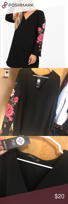 Black plunge neck dress w/ embroidered sleeves Such a cute dress and super comfortable! Never been worn and still has tags! Boohoo Plus Dresses Long Sleeve