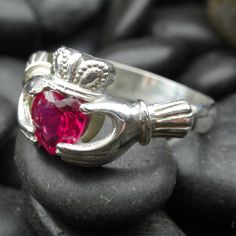 claddagh ruby ring... July the month we were married is ruby!:) I WANT!