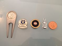 These are the items for the Men's buttonholes - Lee is going to try and find a Parkstone golf club badge / pin so they are all the same size!  The penny is to show you the size, it's not a 5th person!
