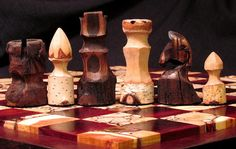 This set at this price would be made from solid Bloodwood 2 inch board spaces and a mix of Inlay light board Spaces . The playing surface would be raised approx 1/4 inch above the trim of the board . The Chess pieces would be carved from river Birch and dark stained Oak $350