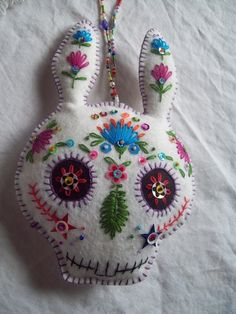 This decoration combines easter with the bright colors of the mexican day of the dead celebration. unique piece brightens up your door, wall, or any space that could use a little festive fun. Great for easter, Dia De Los Muertos, or anytime if you like unique things.