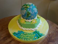 """Happy Earth Day Birthday! - Mommy friend wanted a """"simple globe cake with yellow flowers"""" for her daughter's second birthday which coincides with their celebration of Earth Day. Fondanting a globe shape = NO FUN!"""