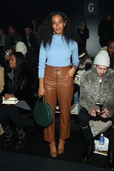 Solange Knowles Pumps - For her shoes, Solange Knowles chose a pair of classic tan Mary Janes.