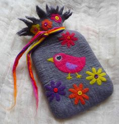 handmade felted hot water bottle cover plus hot water bottle, unique and one of a kind by   Felted Art To Wear   handmade from finest Australian Merino wool using the wet felt technique.  Feeling the chill? Cosy, soft and warm this hot water bottle cover is handmade from finest Australian merino wool tops.  A hot water bottle is just one of those things you MUST HAVE at home! With all this high tech at home it is quite nice to have a cosy low tech piece to give comfort ;o))  Wool has got…