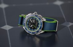 """PROFESSIONAL WATCHES: The Omega Speedmaster Skywalker X-33 """"Solar Impulse"""" Comes with a blue polyamide """"NATO"""" strap with a green border. Retail price is expected to be just over $5,900 (the price of the normal production X-33 Skywalker)."""