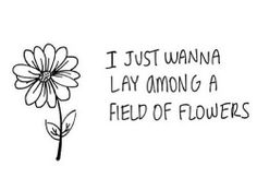 Lay Among a field of flowers