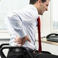 Back pain from normal wear and tear is more common than back pain from ankylosing spondylitis. Find out how to tell the difference.
