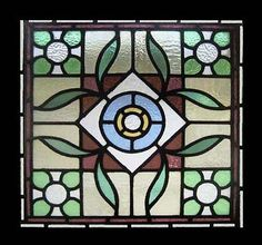 """Amazing Leafy Victorian Antique-English Stained Glass Window, circa 1900. Removed from a property in Cheshire England during refurbishment. Outstanding beauty with exceptional heavy, deeply textured coloured glass. BEAUTIFUL SHADES OF GOLD, GREEN , BLUE & RARE CRANBERRY Frame measures 27 1/4 sq. Glass 24 1/12"""" sq. $1,999 (sale $1,400)"""