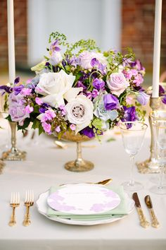 Centerpiece in Shades of Purple | photography by http://kthompsonphotography.com/