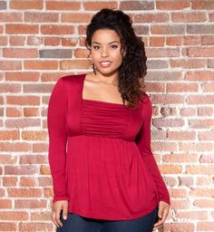 The Rylan Ruched Top by Kiyonna in Rich Ruby is a great way to add some color into your work wardrobe.  We love it paired with a simple, never fail black pencil skirt.