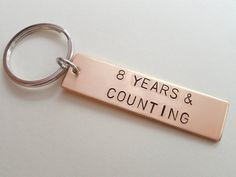 "Bronze Tag Keychain Stamped with ""8 Year & Counting""; Hand Stamped 8 Year Anniversary Couples Keychain"