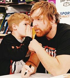 Dean Ambrose: this picture left me speechless so cute.