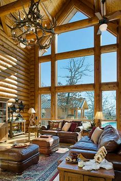 A bright lit great room by Expedition Log Homes, LLC  http://loghomes.org/