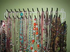 Use a wall tie organizer from The Home Depot to organize necklaces