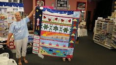 Row by Row Experience winner at Quilts and Lace LLC was Jeanne's quilt, shown here by Betty Taylor.