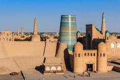 ITCHAN KALA, UZBEKISTAN:  Surrounding the Khiva oasis, the inner town of Itchan Kala, with its 32-foot-high adobe walls, was a vital resting place for caravans preparing to cross the desert to Iran. Despite there only being a few of the city's original monuments remaining, the site is still regarded as an excellent example of central Asian Muslim architecture, with the Djuma Mosque and the 19th-century palaces being of particular note. It was designated a World Heritage Site in 1991.