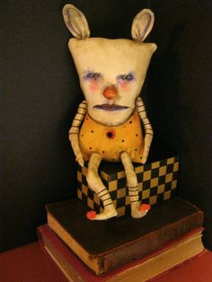 art doll ..... creepy wise rabbit ... 14 inches tall sits or hang on the wall { loop on the back }  hand painted [ I used acrylics, ink and Inktense ] poly ,and then an antique finish is rubbed on and wiped off arms , legs , nose and ears, were stuffed and then hand stitched into the body packed very tightly with a dense cotton stuffing more of a fabric sculpture original by Copyright > Sandy Mastroni thank you ! follow me on Instagram , Face book , Pinterest , Flickr and my blog