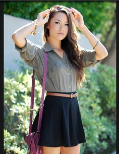 green shirt + navy skirt + belt