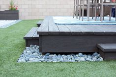 Rocks used as a transition from deck to grass