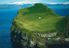 An island off the south coast of Iceland. Yes.  Send me there.  Now.