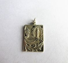 SOLD $16.00  Vintage Mary Etched Sterling Silver RELIGIOUS MEDAL-Catholic by feathersoup on Etsy