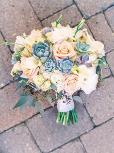 Pastel Wedding Bouquet with Succulents / Photo by Melissa Jill Photography
