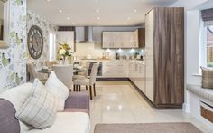 Cala Homes are a luxury home builder and no expense was spared on this fresh, modern interior designed kitchen / dining / living room. Fabulous mink wood casing for the cupboards, it has a French feeling and a witty use of Belynda Sharples' Chicken wallpaper.