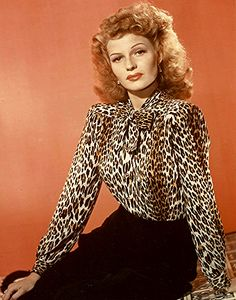 A leopard print blouse and a not too happy looking Rita Hayworth!